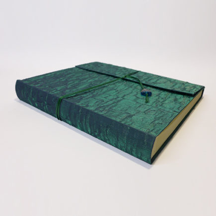 green silk covered photo album